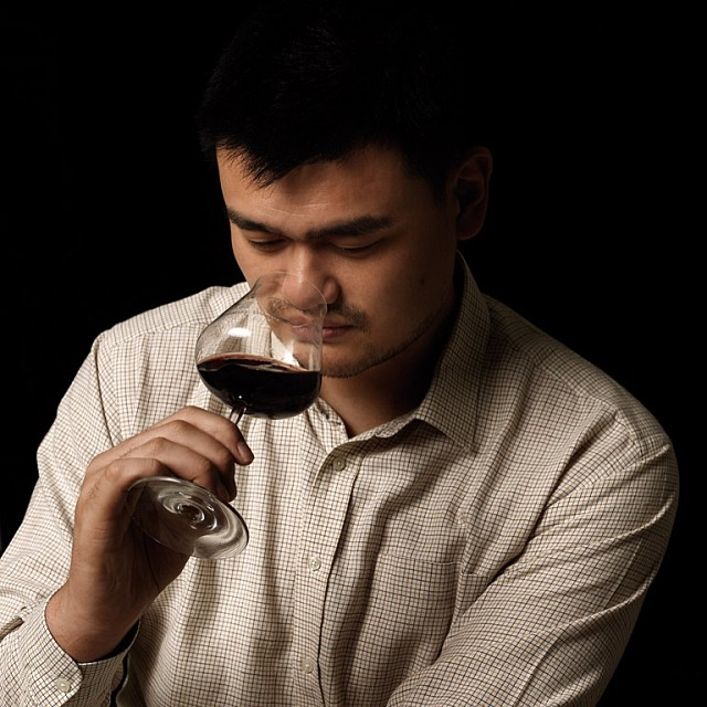 Yao Ming sniffing wine