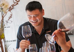 Yao Ming Tasting Wine and Smiling