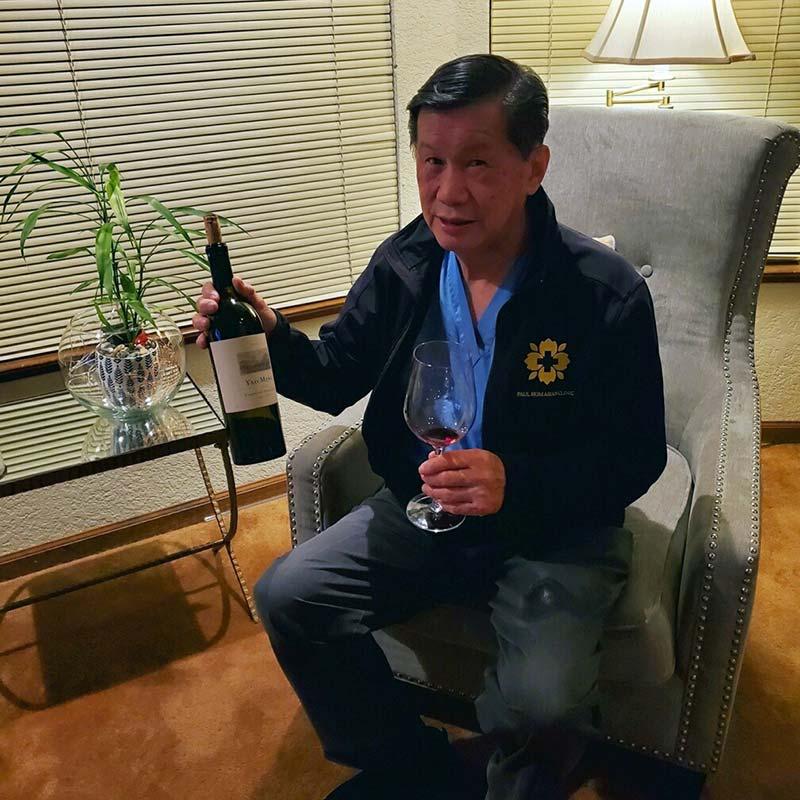 Wine club member showing wine.